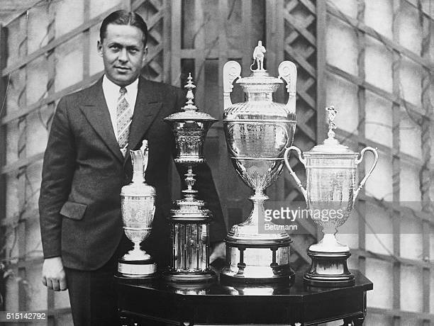 Bobby Jones American golfer standing beside the trophies he won for the 'Grand Slam of Golf' the US Open the British Open the US Amateur and the...