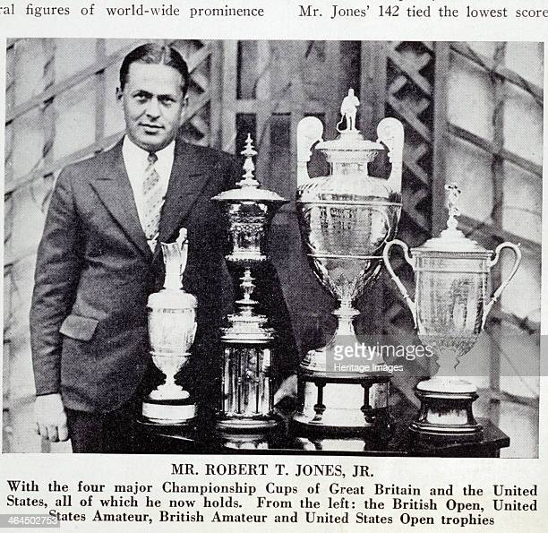 Bobby Jones American golfer with the Grand Slam trophies 1930 From left the British Open US Amateur British Amateur and US Open golf trophies