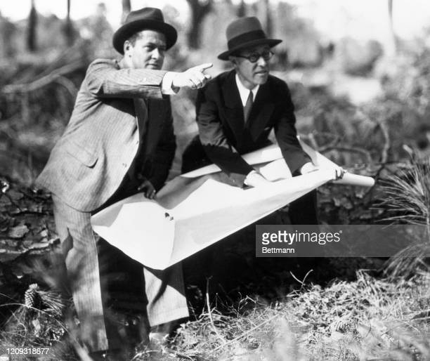Bobby Jones appears to be very much in the rough on his perfect golf course being laid out. He and Wendell Miller , New York engineer, are going over...