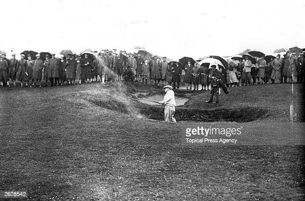 Bobby Jones champion American golfer who won the British Open three times and the US Open four times plays out of a bunker during a match Original...