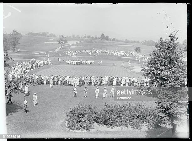 Bobby Jones of Atlanta retained his title when he defeated Watts Gunn also of Atlanta for the National Amateur Golf Championship at Oakmont Country...