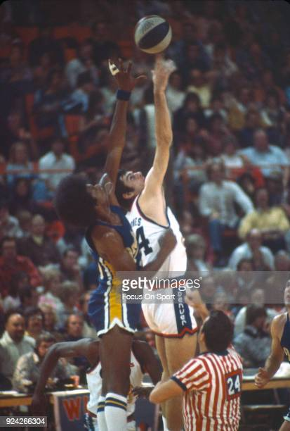 Bobby Jones of the Denver Nuggets battles for a jump ball against the Indiana Pacers during an ABA basketball game circa 1975 at the McNichols Sports...