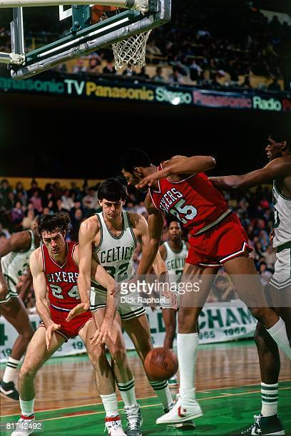 Bobby Jones of the Philadelphia 76ers battles for the loose ball against Kevin McHale of the Boston Celtics during a game played in 1983 at the...