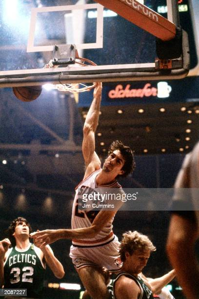 Bobby Jones of the Philadelphia 76ers dunks against Larry Bird of the Boston Celtics in a 1981 season game at the Spectrum in Philadelphia...