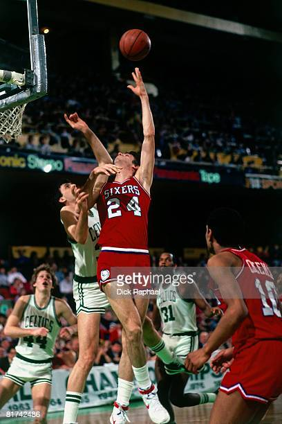 Bobby Jones of the Philadelphia 76ers shoots a hook shot against Kevin McHale of the Boston Celtics during a game played in 1983 at the Boston...