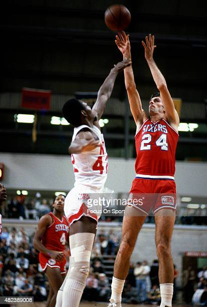 Bobby Jones of the Philadelphia 76ers shoots over Edgar Jones of the New Jersey Nets during an NBA basketball game circa 1980 at the Rutgers Athletic...