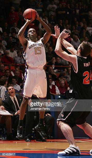 Bobby Jones of the Washington Huskies puts up a shot over Matt Kemper of the Pacific Tigers during the 2005 NCAA division 1 men's basketball...