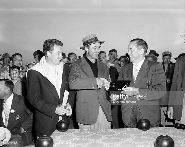 Bobby Jones presents award to Masters Champion Sam Snead with second runner up Jack Burke Jr at the Presentation Ceremony during the 1952 Masters...