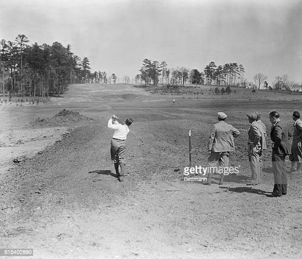 Bobby Jones tries out his perfect course in the making Here's a rear view of the King of Golfers Bobby Jones testing shots on his new National Golf...