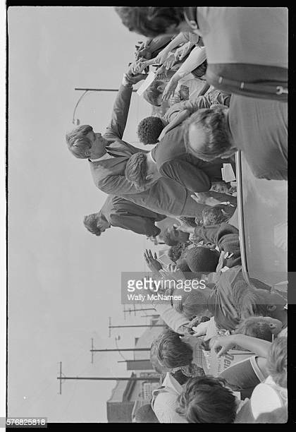 Bobby Kennedy shakes hands while on the presidential primary campaign trail in Indiana