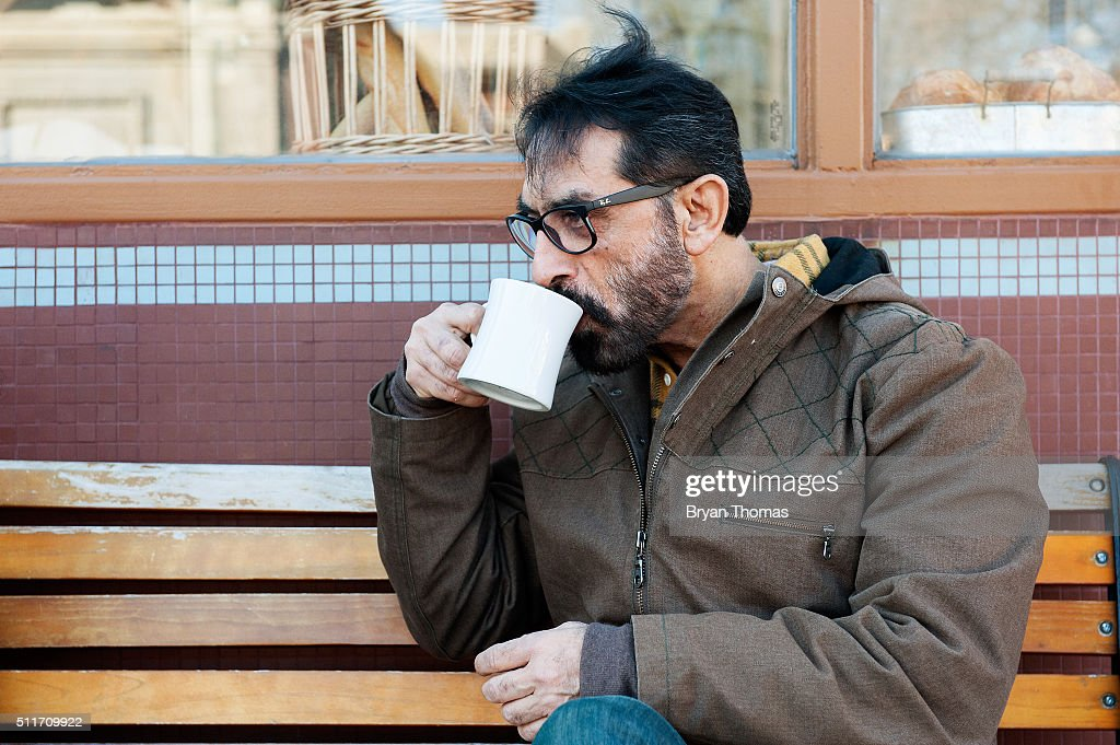 Bobby Khan sips a cup of coffee outside of Colson Patisserie