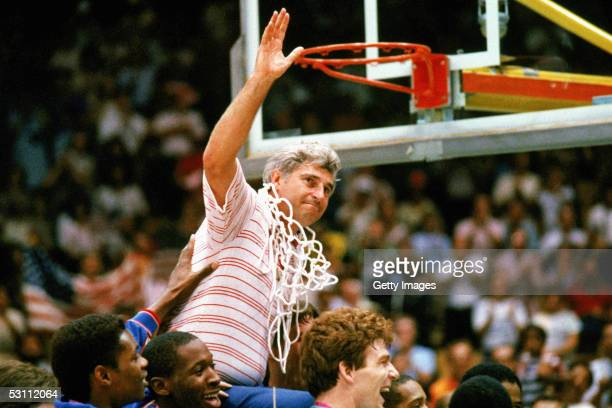 Bobby Knight coach for Indiana University mens basketball cuts down the nets to celebrate a big victory.