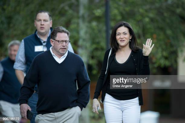 Bobby Kotick chief executive officer of Activision Blizzard and Sheryl Sandberg chief operating officer of Facebook arrive for a morning session of...