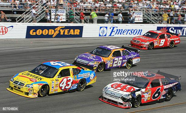 Bobby Labonte driver of the Betty Crocker/Cheerios Dodge leads David Ragan driver of the AAA Ford Jamie McMurray driver of the Crown Royal Ford and...