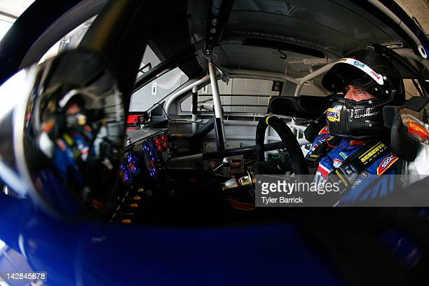 Bobby Labonte driver of the Bush's Bean's/Tom Thumb Toyota sits in his car in the garage during practice for the NASCAR Sprint Cup Series Samsung...