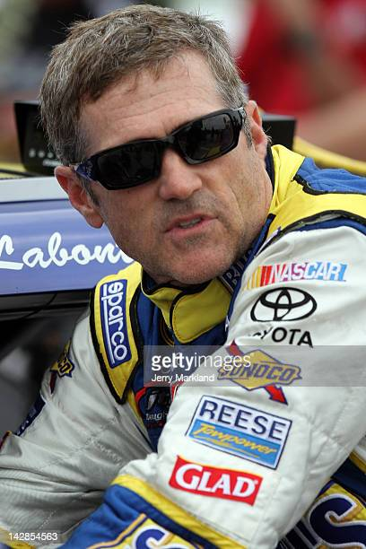Bobby Labonte driver of the Bush's Bean's/Tom Thumb Toyota stands on the grid during qualifying for the NASCAR Sprint Cup Series Samsung Mobile 500...
