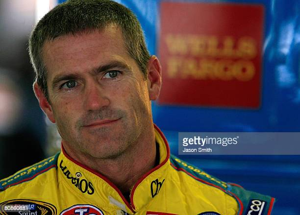 Bobby Labonte driver of the Cheerios Racing/Betty Crocker Dodge stands in the garage during practice for the NASCAR Sprint Cup Series Aaron's 499 at...