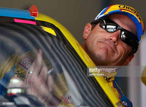 Bobby Labonte driver of the Cheerios/Betty Crocker Dodge gets in his car in the garage during practice for the NASCAR Sprint Cup Series Daytona 500...