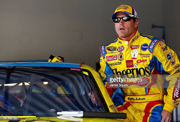 Bobby Labonte driver of the Cheerios/Betty Crocker Dodge gets into his car in the garage during practice for the NASCAR Sprint Cup Series Daytona 500...