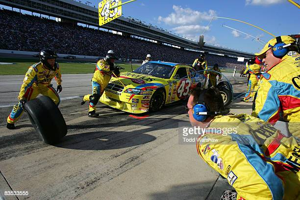 Bobby Labonte driver of the Cheerios/Betty Crocker Dodge makes a pit stop during the NASCAR Sprint Cup Series Dickies 500 at Texas Motor Speedway on...
