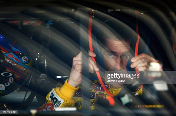 Bobby Labonte driver of the Cheerios/Betty Crocker Dodge sits in his car in the garage during practice for the NASCAR Sprint Cup Series Daytona 500...