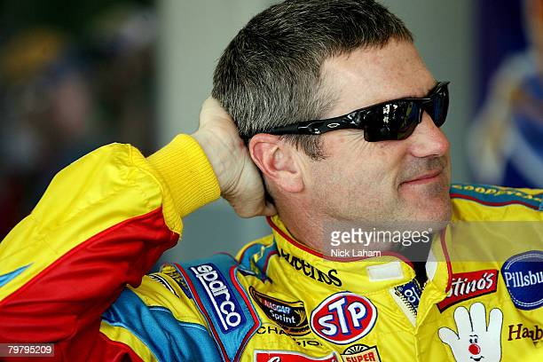 Bobby Labonte driver of the Cheerios/Betty Crocker Dodge stands in the garage during practice for the NASCAR Sprint Cup Series Daytona 500 at Daytona...