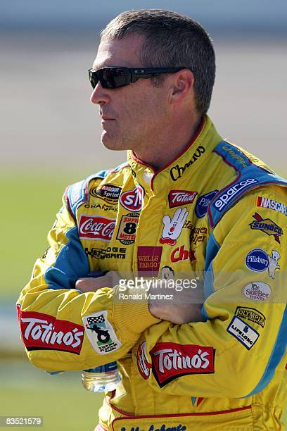 Bobby Labonte driver of the Cheerios/Betty Crocker Dodge stands on pit road during qualifying for the NASCAR Sprint Cup Series Dickies 500 at Texas...