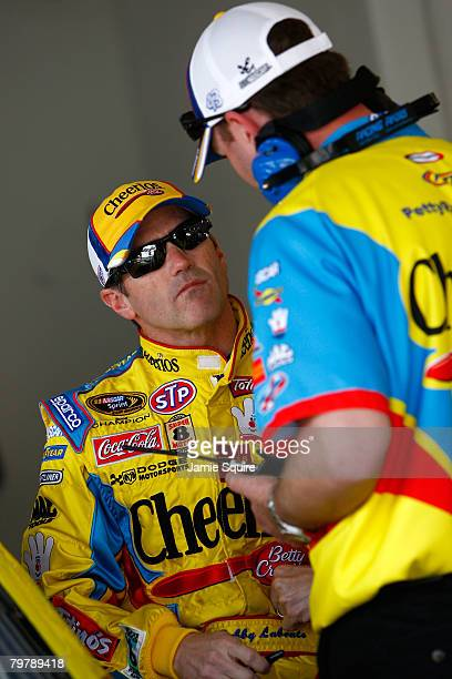 Bobby Labonte driver of the Cheerios/Betty Crocker Dodge talks with a crew member during practice for the NASCAR Sprint Cup Series Daytona 500 at...