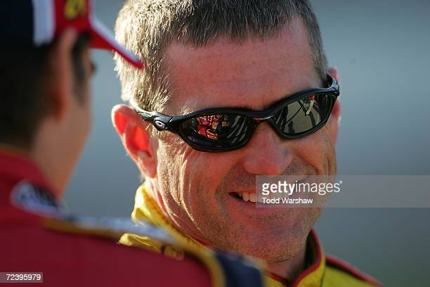 Bobby Labonte driver of the Cheerios/Betty Crocker Dodge talks with Jeff Gordon driver of the DuPont Chevrolet during qualifying for the NASCAR...