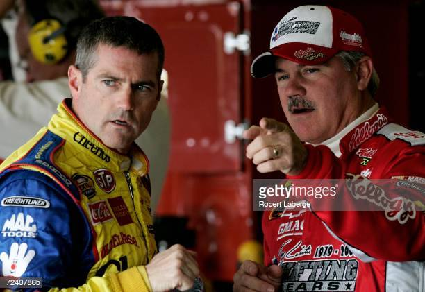 Bobby Labonte driver of the Cheerios/Betty Crocker Dodge talks with his brother Terry labonte driver of the Kellogg's Chevrolet during practice for...