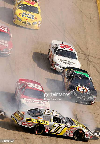 Bobby Labonte driver of the Dollar General Chevrolet spins his car during the NASCAR Busch Series Sharpie Mini 300 at Bristol Motor Speedway on March...