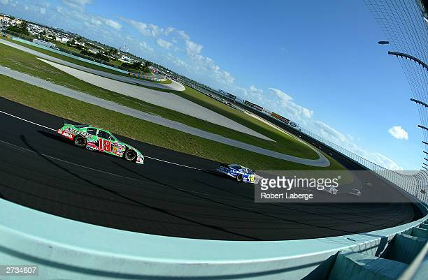 Bobby Labonte driver of the Joe Gibbs Racing Interstate Batteries Chevrolet trails a pack of cars in turn one during the NASCAR Winston Cup Ford 400...