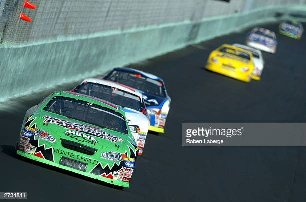 Bobby Labonte driver of the Joe Gibbs Racing Interstate Batteries Chevrolet leads a pack of cars during the NASCAR Winston Cup Ford 400 at the...
