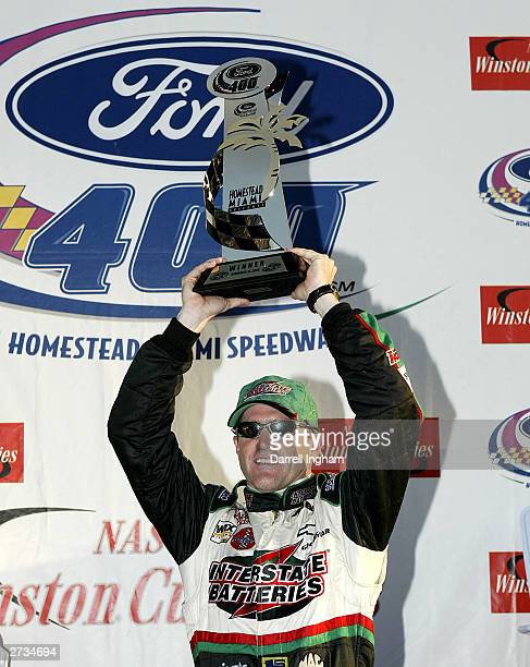 Bobby Labonte driver of the Joe Gibbs Racing Interstate Batteries Chevrolet celebrates winning the NASCAR Winston Cup Ford 400 on November16 2003 at...