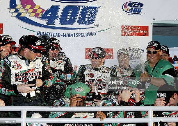 Bobby Labonte driver of the Joe Gibbs Racing Interstate Batteries Chevrolet celebrates with his crew on winning the NASCAR Winston Cup Ford 400 on...