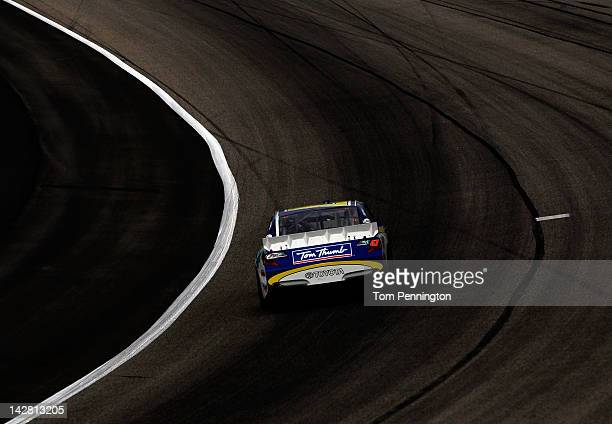 Bobby Labonte drives the Bush's Bean's/Tom Thumb Toyota during practice for the NASCAR Sprint Cup Series Samsung Mobile 500 at Texas Motor Speedway...