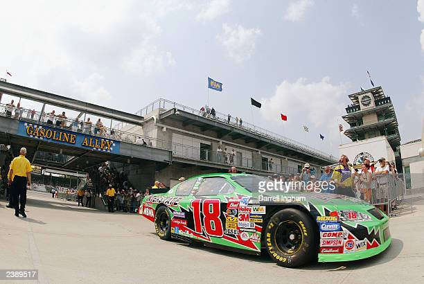 Bobby Labonte in the Joe Gibbs Racing Interstate Batteries Chevrolet passes through Gasoline Alley during practice for the NASCAR Winston Cup...