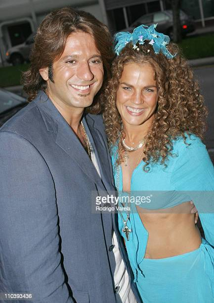 Bobby Larios and Niurka Marcos during Raul de Molina's 'Pictures of a Life Time' Exhibition at Gary Nader Gallery in Coral Gables Florida United...