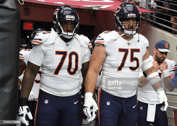 Bobby Massie and Kyle Long of the Chicago Bears get ready to run onto the field prior to a game against the Arizona Cardinals at State Farm Stadium...