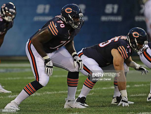 Bobby Massie of and Kyle Long of the Chicago Bears await the snap against the Denver Broncos at Soldier Field on August 11 2016 in Chicago Illinois