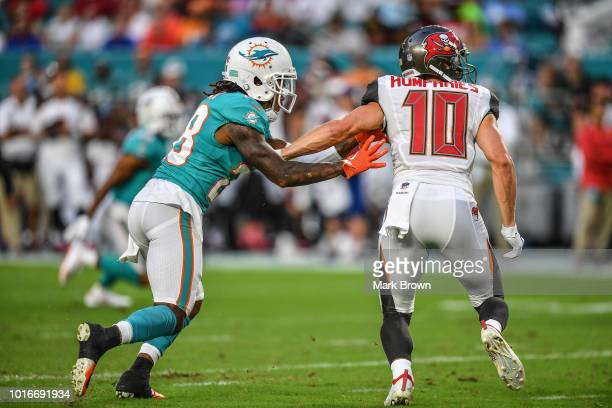 Bobby McCain of the Miami Dolphins defends against Adam Humphries of the Tampa Bay Buccaneers in the first quarter during a preseason game at Hard...