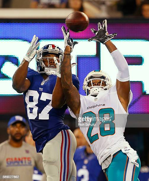 Bobby McCain of the Miami Dolphins intercepts a pass intended for Sterling Shepard of the New York Giants in the second quarter of an NFL preseason...