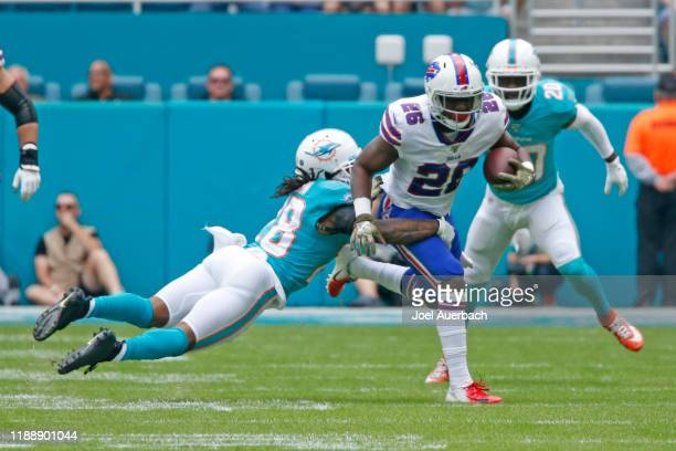 Bobby McCain of the Miami Dolphins is unable to tackle Devin Singletary of the Buffalo Bills as he runs with the ball during an NFL game on November...