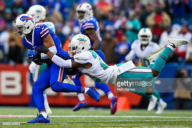 Bobby McCain of the Miami Dolphins makes a diving tackle on Robert Woods of the Buffalo Bills during the second quarter at New Era Field on December...