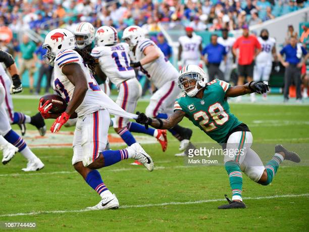 Bobby McCain of the Miami Dolphins makes the tackle on Chris Ivory of the Buffalo Bills during the third quarter against the Buffalo Bills at Hard...