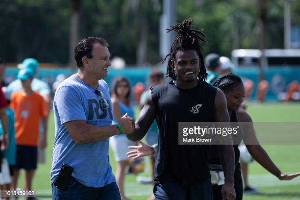 Bobby McCain of the Miami Dolphins meets with agent Drew Rosenhaus during Miami Dolphins Training Camp at Baptist Health Training Facility at Nova...