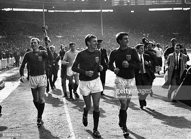 Bobby Moore and his England teammates parading soccer's World Cup trophy around Wembley after beating West Germany in the final in 1966