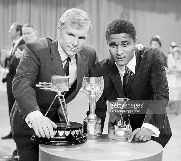 Bobby Moore captain of the England football team with the Jules Rimet trophy and Eusebio the overseas winner during the BBC Sports Personality of the...