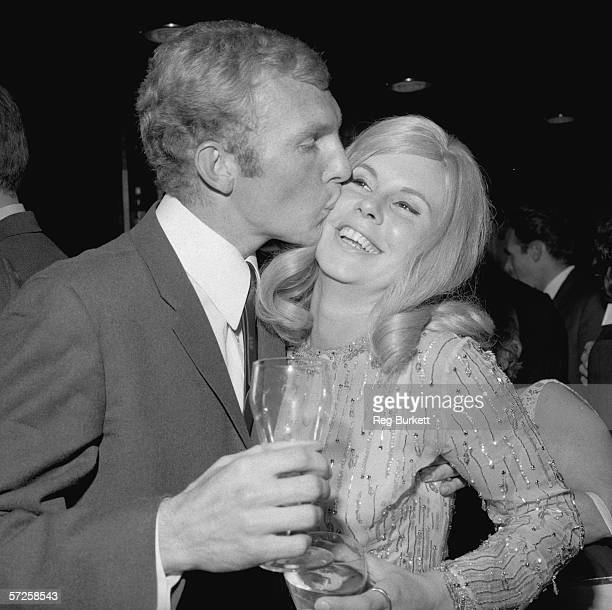 Bobby Moore kisses his wife Tina at a reception for the England football team after their World Cup victory 31st July 1966