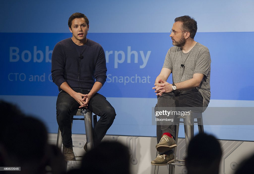 Bobby Murphy, chief technology officer and co-founder of Snapchat Inc., left, speaks as Urs Holzle, vice president of operations for Google Inc., listens during a Google Cloud event in San Francisco, California, U.S., on Thursday, March 25, 2014. Google Inc. cut prices on some Internet-based services for businesses by 30 percent or more, stepping up a challenge to Amazon.com Inc. and Microsoft Corp. in cloud computing. Photographer: David Paul Morris/Bloomberg via Getty Images